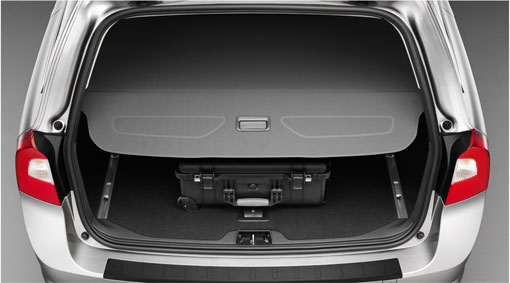 Cargo compartment cover A stylish, retractable compartment cover that conceals luggage in the cargo area. Diagram